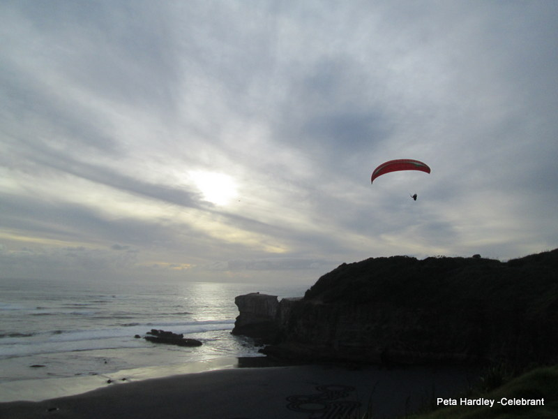 Paraglider at Muriwai Sunset